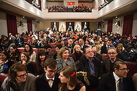 SLIEMA, MALTA - 8 FEBRUARY 2016: The Maltese audience wait the start of the touring Hamlet, performed by the Shakespeare's Globe theatre company, at the Salesian Theatre in Sliema, Malta, on February 8th 2016.<br /> <br /> The touring Hamlet, performed by the Shakespeare's Globe theatre company, is part of the Globe to Globe tour that set off in April 2014 (on the 450th anniversary of Shakespeare's birth) with the ambitious intention of visiting every country in the world over 2 years. The crew is composed of a total of sixteen men and women: four stage managers and twelve twelve actors  actors perform over two dozen parts on a stripped-down wooden stage. So far Hamlet has been performed in over 150 countries, to more than 100,000 people and travelled over 150,000 miles. The tour was granted UNESCO patronage for its engagement with local communities and its promotion of cultural education. Hamlet was also played for many dsiplaced people around the world. It was performed in the Zaatari camp on the border between Syria and Jordan, for Central African Republic refugees in Cameroon, and for Yemeni people in Djibouti. On February 3rd it was performed to about 300 refugees in Calais at the camp known as the Jungle.
