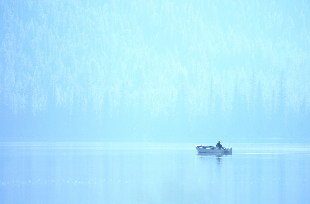 Early morning fisherman in the mist coming off Stanley Lake.
