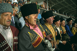VLADIKAVKAZ, RUSSIA - Tuesday, September 12, 1995: Russian football supporters in national costume before the UEFA Cup 1st Round 1st Leg match between FC Alania Spartak Vladikavkaz and Liverpool at the Republican Spartak Stadium. (Photo by David Rawcliffe/Propaganda)