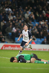MANCHESTER, ENGLAND - WEDNESDAY, JANUARY 4th, 2006:Tottenham Hotspur's Robbie Keane celebrates scoring the second goal as Manchester City's goalkeeper David James looks dejected during the Premiership match at the City of Manchester Stadium. (Pic by David Rawcliffe/Propaganda)