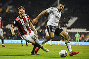 Sheffield United Defender Richard Stearman (19) and Fulham Forward Aleksandar Mitrovic (32) battle for the ball during the EFL Sky Bet Championship match between Fulham and Sheffield United at Craven Cottage, London, England on 6 March 2018. Picture by Stephen Wright.