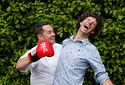 Repro Free: 30/06/2013 <br /> Celbrity Chef Nevin Maguire is pictured as he slogged it out with owner of the Gardenworld Kilquade during the auction for a signed pair of Katie Taylor's boxing gloves at the Gardenworld inaugural Family Garden Party in aid of Down Syndrome Ireland and Lauralynn Children's Hospice. Picture Andres Poveda