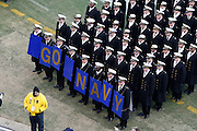 "6 Dec 2008: Navy Midshipman hold a ""Go Navy"" sign on the field before the Army / Navy game December 6th, 2008. At Lincoln Financial Field in Philadelphia, Pennsylvania."