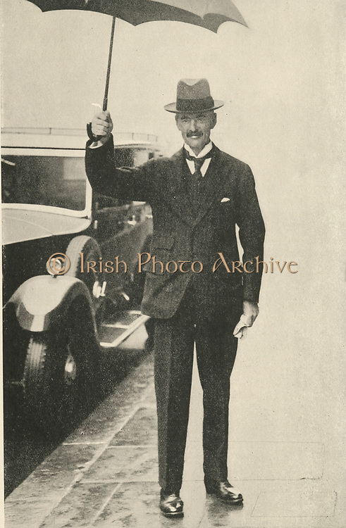 '(Arthur) Neville Chamberlain (1869-1940) English Conservative politician, Prime Minister of the United Kingdom 1937-1940, Holding an umbrella in London on a rainy day.'