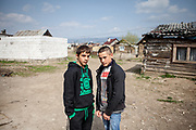 Portrait of two teenagers which are inhabitants of the Roma settlement in Ostrovany.
