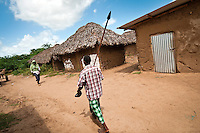Most Orma carry spears and pangas (machetes) at all times, fearing another Pokomo attack. Madingo village, Tana Delta. In the run up to Kenya's Match 4 elections, many worry that the recent ethnic clashes in Tana Delta area could be a warning of violence to come.
