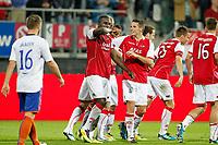 ALKMAAR - AZ - Aalesunds, voetbal,  seizoen 2011-2012, 25-08-2011, Europa League, AFAS Stadion, 6-0, AZ speler Jozy Altidore (2vl) heeft de 4-0 gescoord, AZ speler Nick Viergever (3vl) feliciteert hem, Aalesunds speler Enar Jaager (l) staat er teleurgesteld bij.