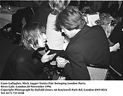 Liam Gallagher, Mick Jagger<br /> Vanity Fair Swinging London Party. River Cafe. London.20 November 1996.<br />Copyright Photograph by Dafydd Jones<br />66 Stockwell Park Rd. London SW9 0DA<br />Tel. 0171 733 0108