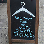 Blackboard humorous  store outdoor sign. <br /> <br /> &quot;Life is Too Short to Wear Boring Cloths&quot;