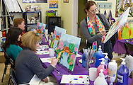 Campbell Hall, New York - Women work on their paintings at The Art Cottage on April 9, 2014.
