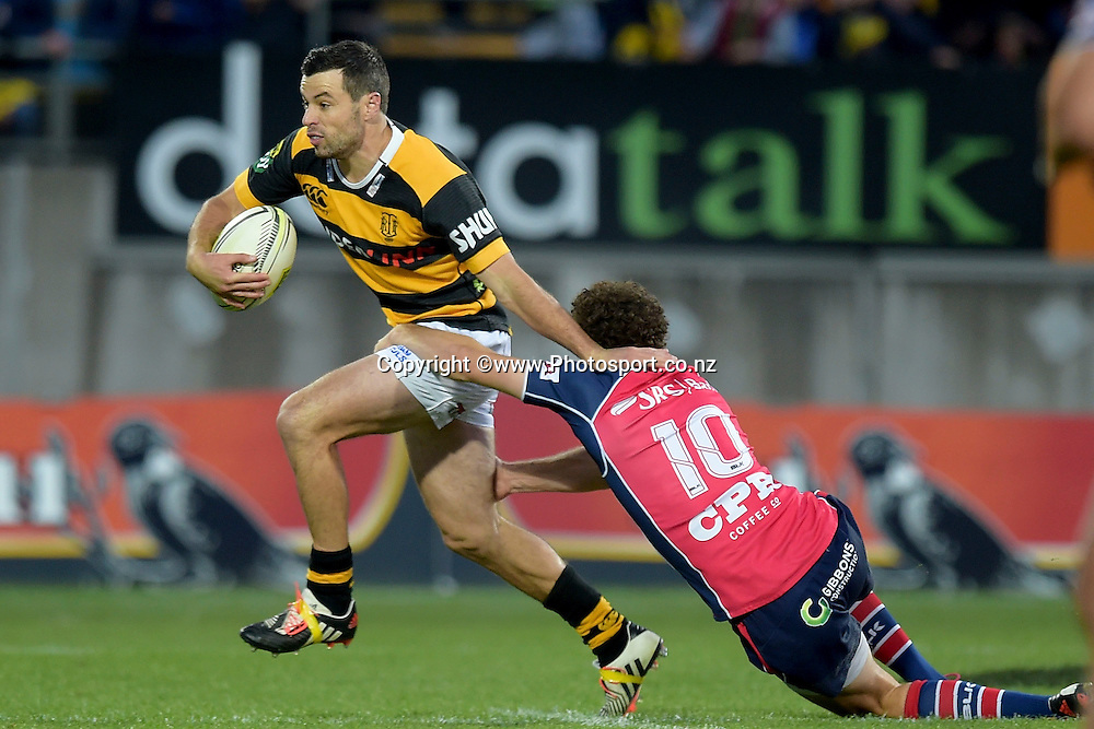 Taranaki's James Marshall (L) is tackled by Tasman Makos Marty Banks during the ITM Cup Premiership Final between Taranaki & Tasman at Yarrow Stadium in New Plymouth, New Zealand, 25th October 2014. Photo: Marty Melville/Photosport.co.nz