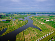 "Nederland, Overijssel, Gemeente Kampen; 21–06-2020; het Reevediep richting monding in het Revemeer (voorheen Drontermeer). Rechts de dijk Slaper, links de Noordwendigedijk, Flevoland aan de horizon.<br /> Het Reevediep is aangelegd in het kader van het project Ruimte voor de Rivier om bij hoogwater water af te voeren voordat dit het nabij gelegen Kampen bereikt, direct naar het IJsselmeer, de 'bypass Kampen'. Het Reevediepgebied is ook een natuurgebied en vormt een ecologische verbindingszone tussen rivier de IJssel en Drontermeer.<br /> Reevediep towards the mouth in the Revemeer (formerly Drontermeer). On the right the dike Slaper, on the left the Noordwendigedijk, Flevoland on the horizon.<br /> The Reevediep has been constructed as part of the Room for the River project, and functions to discharge high waters before reaching the nearby Kampen, directly to the IJsselmeer, the ""bypass Kampen"". The Reevediep area is also a nature reserve and forms an ecological connecting zone between the river IJssel and Drontermeer.<br /> <br /> luchtfoto (toeslag op standard tarieven);<br /> aerial photo (additional fee required)<br /> copyright © 2020 foto/photo Siebe Swart"