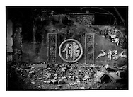 After demolition: Same Buddhist temple, completely flattened except for some Chinese characters fashion into a wall, is ready for the inundation from the Three Gorges (of the Yangtze River) Dam hundreds of kilometers downstream, Fengdu, China.
