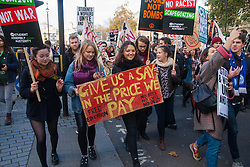 London, November 19th 2014. Thousands of students march through central London, demanding that education fees are scrapped by the government. PICTURED: Stdents demand more of a say in the price they pay for their university degrees, with many saddled by debt for years after graduating.