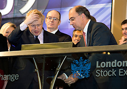 © London News Pictures. 12/02/2013 . London, UK. Mayor Of London, BORIS JOHNSON (left) looks puzzled as he opens the days trading at the London Stock Exchange with XAVIER ROLET, CEO of London Stock Exchange Group (right centre).  Photo credit : Ben Cawthra/LNP