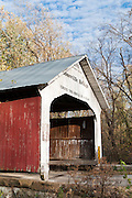"Roseville Covered Bridge (263 feet long) was built in Burr Arch style over Big Raccoon Creek in 1910 by Van Fossen in Parke County, Indiana, USA. Red and white paint protects the wood. The traditional ""Cross this bridge at a walk"" sign requires slow vehicle speed."