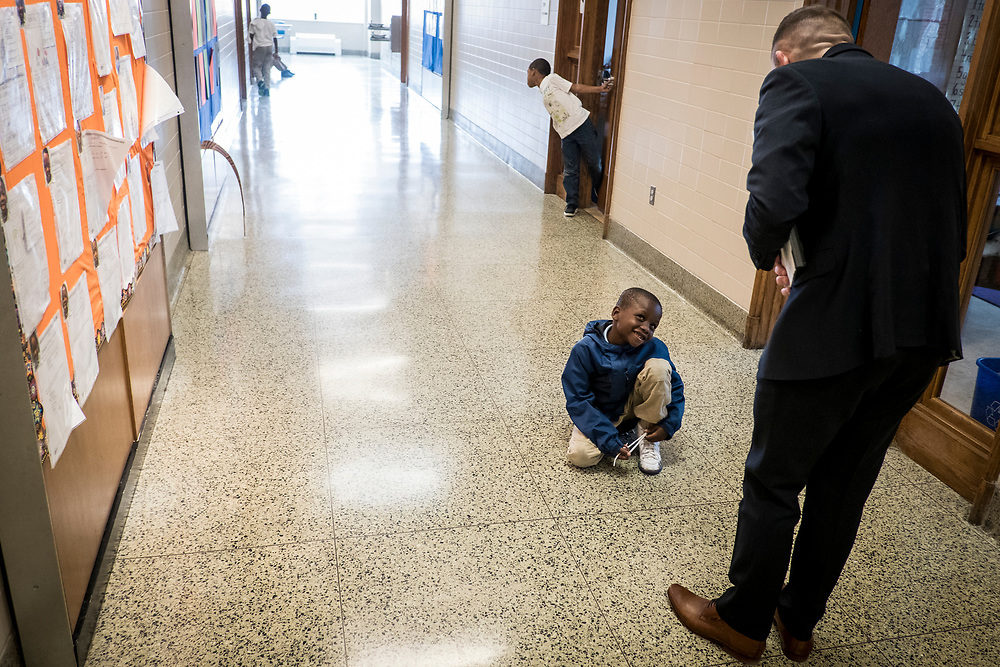 Eric Christopher, Leap ELA Instructional Coach at Turner Elementary School in Washington, D.C., talks to a student in the hallway on Wednesday, May 4, 2017.