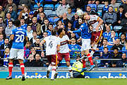 Adam Thompson (2) of Bradford City leaps above Brett Pitman (8) of Portsmouth to head the ball clear during the EFL Sky Bet League 1 match between Portsmouth and Bradford City at Fratton Park, Portsmouth, England on 28 October 2017. Photo by Graham Hunt.