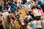 In this festival, horses are ridden up a very steep slope. It is said that if they make it over, then it is a good omen for the rice harvest later in the year. Conversely, if the horses fail, then it is said that the crops may fail.