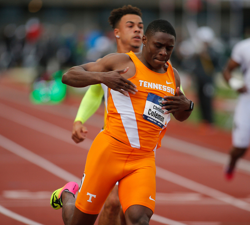 Tennessee's Christian Coleman pounds his chest after wining the men's 100 meters in the time of 10.04 seconds on the third day of the NCAA outdoor college track and field championships in Eugene, Ore., Friday, June 9, 2017. (AP Photo/Timothy J. Gonzalez)