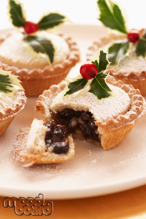 Decorated mince pies on plate close-up