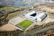 Nederland, Gelderland, Arnhem, 11-02-2008; Gelredome, overdekt voetbalstadion in de wijk Elden met Vitesse als thuisclub; de plassen van Meinerswijk en de Rijn in de achtergrond; het stadion wordt ook gebruikt voor concerten en evenementen; het multifunctionele superstadion heeft een verschuifbaar dak (afhankelijk van het weer is het dak geopend of gesloten) en een verplaatsbare grasbak met verschuifbaar veld; het voetbaldveld krijgt op deze wijze voldoende zonlicht, de betonnen vloer binnen kan gebruikt worden voor manifestaties e.d. zonder dat het gras beschadigd; ; stadion, voetbalclub, voetbal, manifestatie, evenement, concert, Gelredrome, gelre dome, grasmat, stadiontheater, ..luchtfoto (toeslag); aerial photo (additional fee required); .foto Siebe Swart / photo Siebe Swart