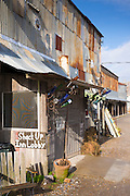 Front entrance with abandoned junk at The Shack Up Inn cotton sharecroppers theme hotel, Clarksdale, Mississippi, USA