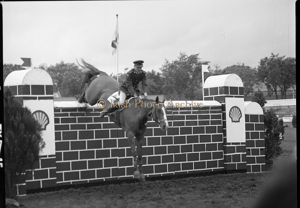 Shell Sponsored Events At The Dublin Horse Show.(R39).1986..07.08.1986..08.07.1986..7th August 1986..At the Horse Show Shell sponsored both the Speed and Power competition and The Puissance..The Speed and Power event was won by Hap Hanson riding 'Gambrinus'. The Puissance was shared by Capt John Ledingham (Irl) on 'Kilcoltrim' and Nick Skelton (GB) on 'Raffles Apollo' who both cleared the high wall at 7feet...Image shows Capt John Ledingham (IRL) on 'Kilcoltrim' taking part in the Shell Puissance event