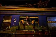 Un uomo si affaccia dal finestrino del treno Presevo-Sid. Vicino al One Stop Centre, Presevo   A man looks out from Presevo - Sid the train window. Near the One Stop Centre, Presevo