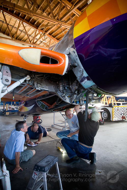 (L-R) Team Lead Alby Redick, Mechanics Rob Grosvenor and Keith Geary, along with Crew Chief Dave Cornell inspect Rare Bear's lower aft engine compartment.