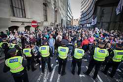 © Licensed to London News Pictures . 27/09/2018. London, UK. Protestors gather outside the Old Bailey as former EDL leader Tommy Robinson (real name Stephen Yaxley-Lennon )  starts his retrial for Contempt of Court following his actions outside Leeds Crown Court in May 2018 . Robinson was already serving a suspended sentence for the same offence when convicted in May and served time in jail as a consequence , but the newer conviction was quashed by the Court of Appeal and a retrial ordered . Photo credit: Peter Macdiarmid/LNP