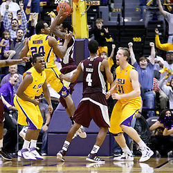February 14, 2012; Baton Rouge, LA; LSU Tigers guard Anthony Hickey (1) celebrates with teammates after hitting a game winning shot in overtime against the Mississippi State Bulldogs at the Pete Maravich Assembly Center. LSU defeated Mississippi State 69-67. Mandatory Credit: Derick E. Hingle-US PRESSWIRE