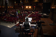 Pianist Jim Dickson entertains the audience prior to an evening movie at the 100-year-old Patricia Theatre in Powell River, BC (2013)