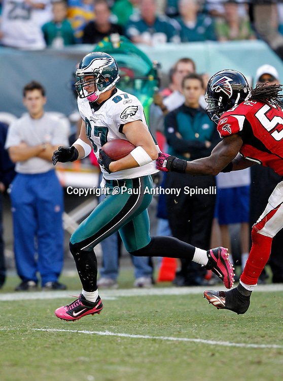 Philadelphia Eagles tight end Brent Celek (87) catches a late fourth quarter pass while being chased by Atlanta Falcons linebacker Mike Peterson (53) during the NFL week 6 football game against the Atlanta Falcons on Sunday, October 17, 2010 in Philadelphia, Pennsylvania. The Eagles won the game 31-17. (©Paul Anthony Spinelli)