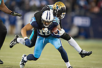 NASHVILLE, TN - DECEMBER 31:  Rishard Matthews #18 of the Tennessee Titans is tackled from behind by Barry Church #42 of the Jacksonville Jaguars at Nissan Stadium on December 31, 2017 in Nashville, Tennessee.  The Titans defeated the Jaguars 15-10.  (Photo by Wesley Hitt/Getty Images) *** Local Caption *** Rishard Matthews; Barry Church