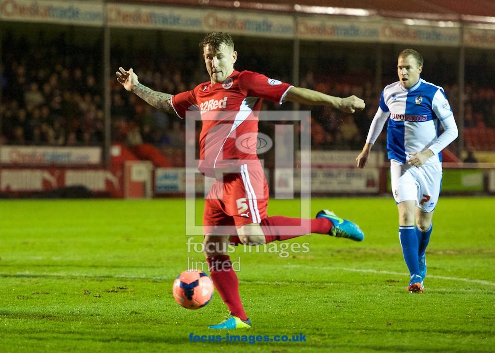 Picture by Alan Stanford/Focus Images Ltd +44 7915 056117<br /> 08/01/2014<br /> Kyle McFadzean of Crawley Town has a shot on goal during the The FA Cup match at Broadfield Stadium, Crawley.