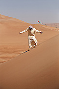 Sandboarding in the desert of Dubai