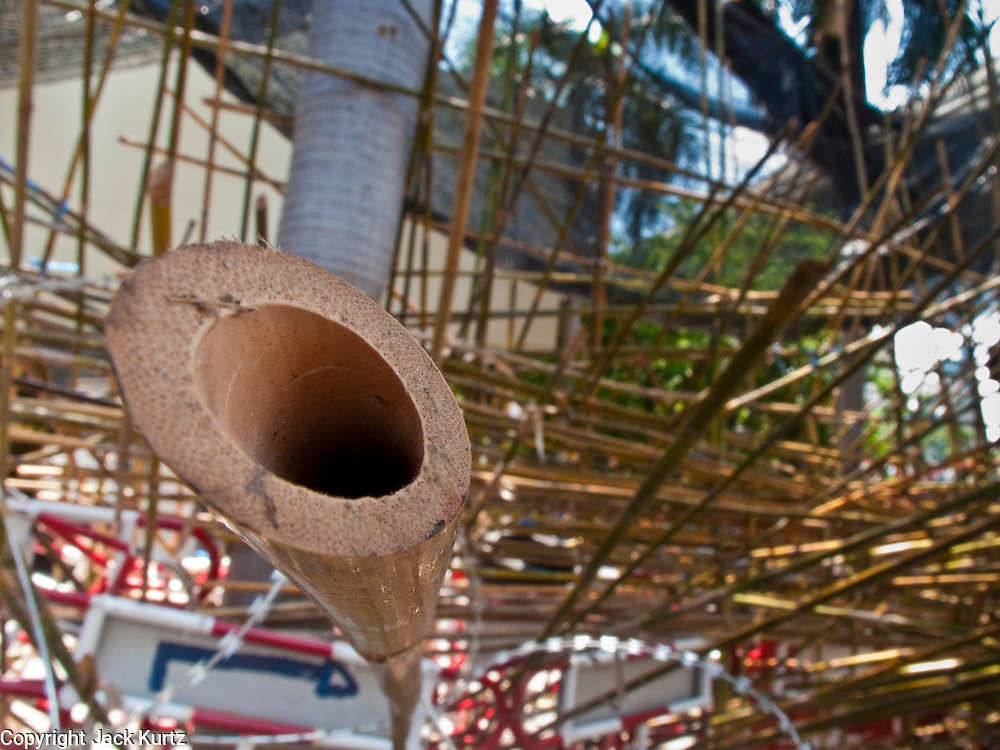 Apr. 30 - BANGKOK, THAILAND: A sharpened bamboo stake at a Red Shirt barricade in Bangkok Friday. The Red Shirts moved one of their barricades in the Sala Daeng Intersection in Bangkok Friday In one of the first positive moves to take place since the Red Shirts occupied central Bangkok in early April. The barricade was moved far enough back to open one lane of traffic on  Ratchadamri Street to allow ambulance access to King Chulalongkorn Memorial Hospital, a large hospital at the intersection. Many of the patients in the hospital have been moved to other hospitals because a group of Red Shirts entered the hospital Thursday looking for Thai security personnel, who were not in the hospital. The stand off between the Red Shirts and the government enters its third month in May. The Red Shirts continue to call for Thai Prime Minister Abhisit Vejjajiva to step down and dissolve parliament and demand the return of ousted Prime Minister Thaksin Shinawatra.   PHOTO BY JACK KURTZ