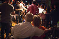 Medellin, Colombia- March 15, 2015: Patrons take a break from the dance floor at Son Havana, an intimate Cuban-themed salsa bar in the Laureles neighborhood. CREDIT: Chris Carmichael for The New York Times