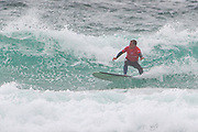 Adrian Napper (UK) executes a bottom turn during the Boardmasters Longboard Pro at Fistral Beach, Newquay, Cornwall, United Kingdom on 10 August 2019.