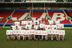 WIGAN, ENGLAND - Tuesday, January 6, 2004: Wigan Warriors' layers with hand prints for Project Child charity pictured during the team's pre-season photo-call at the JJB Stadium. (Pic by David Rawcliffe/Propaganda)