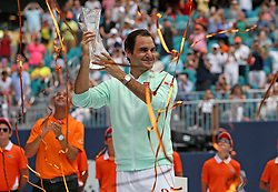 Roger Federer, of Switzerland, poses with the trophy after defeating John Isner, of the United States, 6-1, 6-4 during the final of the Miami Open tennis tournament at Hard Rock Stadium on Sunday, March 31, 2019, in Miami Gardens, Fla. Photo by David Santiago/Miami Herald/TNS/ABACARESS.COM
