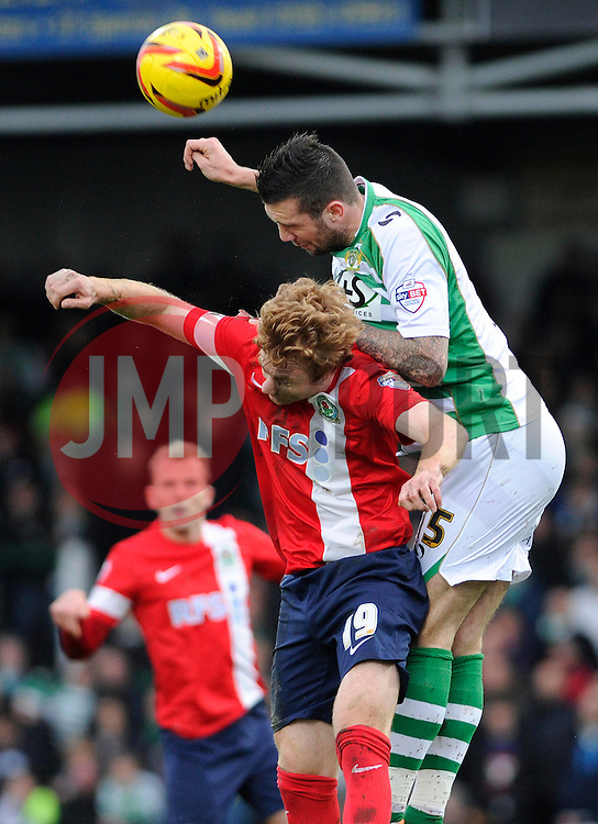 Yeovil Town's Shane Duffy is challenged by Blackburn Rovers' Chris Taylor - Photo mandatory by-line: Dougie Allward/JMP - Tel: Mobile: 07966 386802 21/12/2013 - SPORT - FOOTBALL - Huish Park - Yeovil - Yeovil Town v Blackburn Rovers - Sky Bet Championship