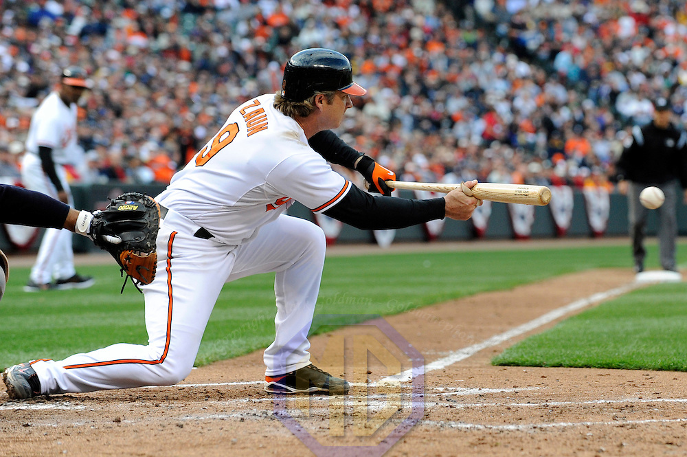 06 April 2009:  Baltimore Orioles catcher Gregg Zaun (9) attempts a sacrifice bunt in the 4th inning against the New York Yankees at Camden Yards in Baltimore, MD.  The Orioles defeated the Yankees 10-5 in the home opener to start the major league regular season.  ****For Editorial Use Only****
