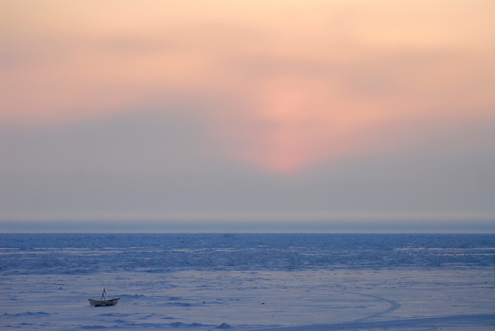 Barrow, Alaska. Umiaq or skin boat on the ice over the the Arctic Ocean, by the beach during Spring. May 2007