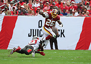 Nov 11, 2018; Tampa, FL USA: Washington Redskins running back Adrian Peterson (26) runs for yardage against the Tampa Bay Buccaneers at Raymond James Stadium. The Redskins beat the Buccaneers 16-3. (Steve Jacobson/Image of Sport)