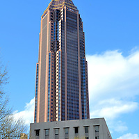 Bank of America Plaza in Atlanta, Georgia<br /> The skyline of Atlanta, Georgia has about 40 skyscrapers above 400 feet. Since 1992, this tower has dwarfed them all at 1,023 feet. It is also the tallest outside of New York City or Chicago. Initially named NationsBank Plaza, the Art Deco office building is now the Bank of America Plaza. On top is a 90 foot spire. The 23 karat gold leaf glistens in the Georgian sunshine.
