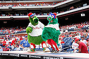 PHILADELPHIA, PA - JUNE 3: Philadelphia Phillies mascot Phillie Phanatic clowns around with a young fan dressed as the mascot prior to the game against the Miami Marlins at Citizens Bank Park on June 3, 2012 in Philadelphia, Pennsylvania. The Marlins won 5-1. (Photo by Joe Robbins)