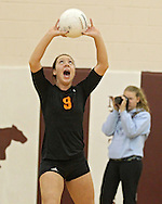 Solon's Emma Rickels (9) sets the ball during the WaMaC Tournament semifinal game at Mount Vernon High School in Mount Vernon on Thursday October 11, 2012. Solon defeated Mount Vernon 26-24, 25-22.