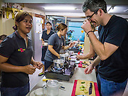 "29 MARCH 2013 - BANGKOK, THAILAND: Saiyuud Diwong ""Poo"" works with student/reporter Kent Annan in her cooking school.    PHOTO BY JACK KURTZ"